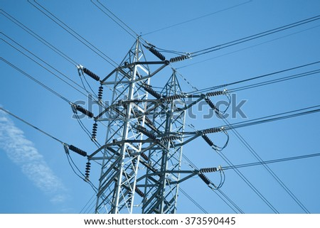 Utility pole for electricity over blue sky