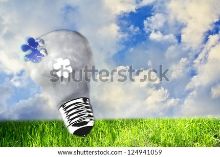 utopic nature and lightbulb, concept of ecology - stock photo