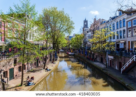 Utrecht, Netherlands - April 20, 2016: old town scene at a canal in Utrecht. The university city Utrecht is the 4th largest city of the Netherlands and capital of the same named province - stock photo