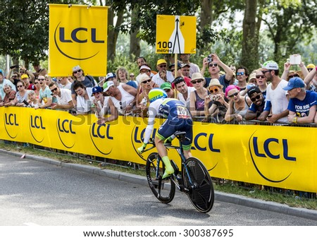 UTRECHT,NETHERLANDS JUL 4: The British cyclist Simon Yates of Orica-GreenEDGE Team riding during the stage 1 (individual time trial) of Le Tour de France 2015 in Utrecht,Netherlands on 04 July 2015  - stock photo