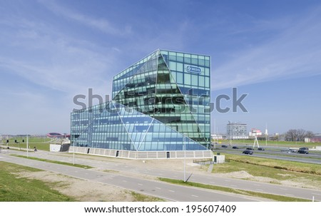 UTRECHT, NETHERLANDS - MARCH 29, 2014: Exterior of a modern glass office building. Because of the central location in the country, it is a perfect base for international orientated businesses - stock photo