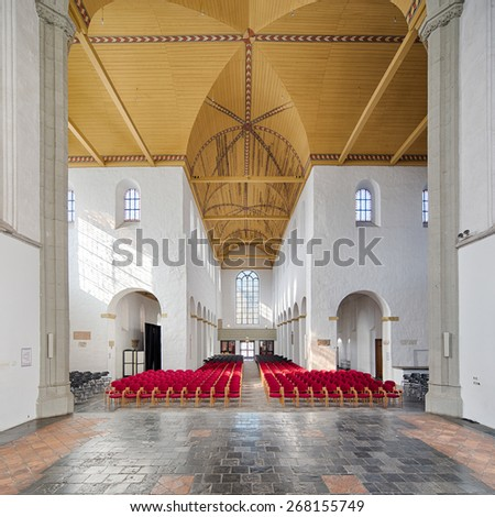 UTRECHT, NETHERLANDS - MARCH 12: Wide angle symmetrical composition of the interior of John Church, Janskerk, a historical church of over 1000 years old, on March 12, 2015 in Utrecht, Netherlands. - stock photo