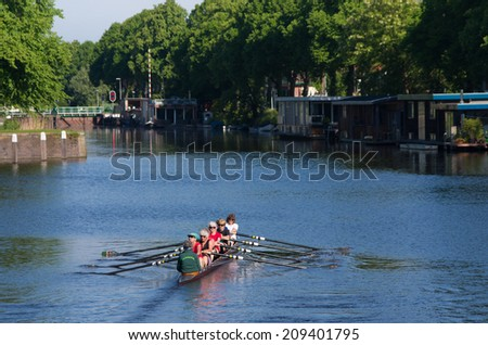 UTRECHT, NETHERLANDS - MAY 17, 2014: Unknown female senior rowers. Until the 1972 Olympics, the sport was preserved for men. In 1976 women were for the first time in this sport in action at the Games. - stock photo