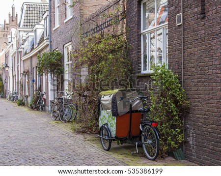 UTRECHT, NETHERLANDS, on March 30, 2016. Urban view. The bicycle is parked on the sidewalk