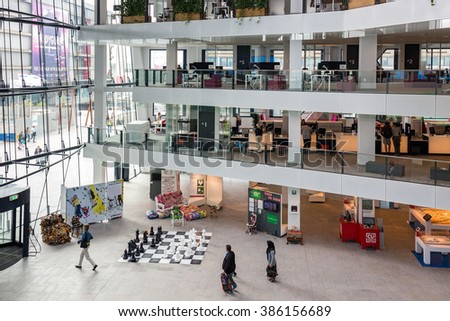 UTRECHT, THE NETHERLANDS - AUG 24: Atrium of the city hall of Utrecht with several floors and people visiting the building on August 24, 2015 in Utrecht, the Netherlands