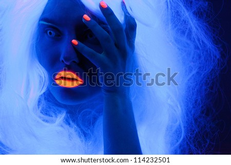Uv light portrait, woman with glowing accessories and make up - stock photo