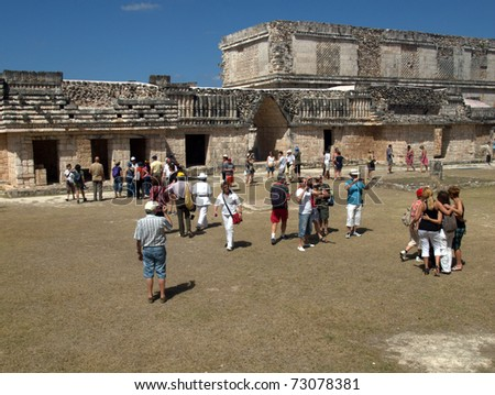 UXMAL, MEXICO-CIRCA MAR 2011: Tourists view the ruins circa March 2011 in Uxmal, Mexico.The city was abandoned over 600 years ago, but now competes with Chichen Itza, one of the 7 wonders of the world - stock photo