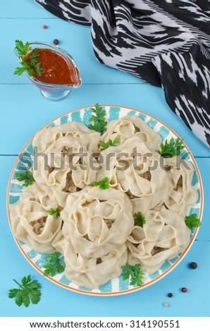Uzbek manty. Dumplings cooked in a double boiler - stock photo