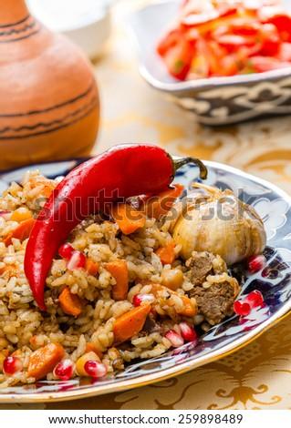 Uzbek national food pilaf - stock photo