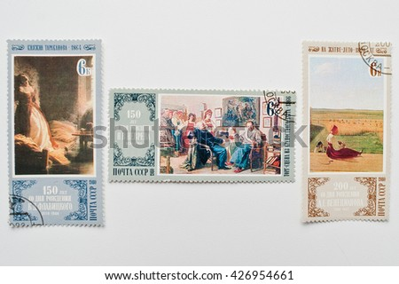 UZHGOROD, UKRAINE - CIRCA MAY, 2016: Collection of postage stamps printed in USSR shows 150th and 200th birth anniversaries of N.V.Nevrev, K.D.Flavitsky and Venecianov,  circa 1980 - stock photo