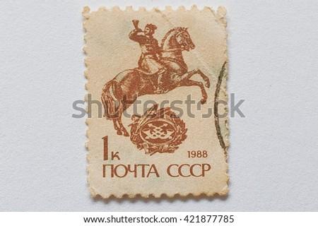 UZHGOROD, UKRAINE - CIRCA MAY, 2016: Postage stamp printed in USSR,  shows rider on the horse, circa 1988 - stock photo