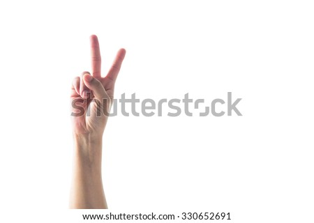 V shape hand sign for voting campaign: Universal sign for peace: Isolated girl human hand with victory symbol on white background: Female equality, woman rights, and feminism symbolic concept   - stock photo