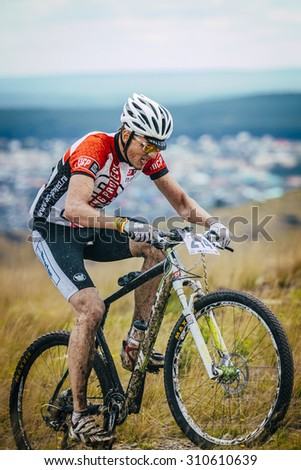 "V.Ufaley, Russia - August 09, 2015: cyclist riding steep hill during race ""Big stone"", V.Ufaley, Russia - August 09, 2015"