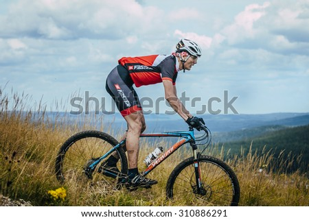 """V.Ufaley, Russia - August 09, 2015: old racer on the mountain bike downhill during race """"Big stone"""", V.Ufaley, Russia - August 09, 2015 - stock photo"""