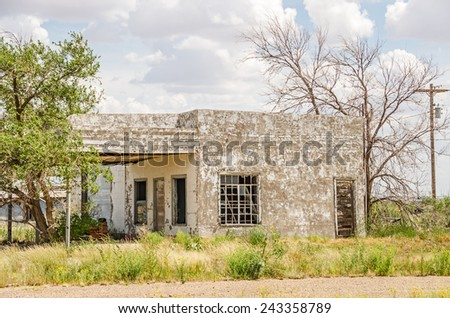 Vacant, abandoned, and vandalized service station along Route 66 - stock photo