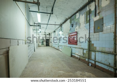 Vacant abandoned office room in old building - stock photo