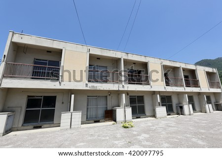 Vacant old Japanese apartment building  - stock photo