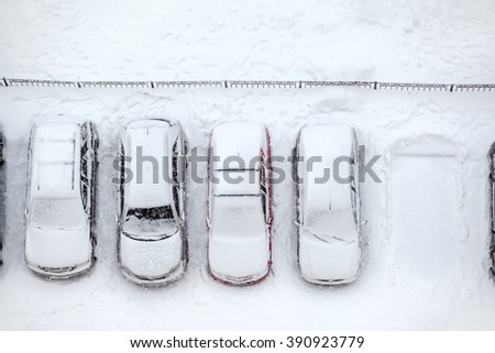 Vacant parking place is in line of vehicles, winter time, view from above - stock photo