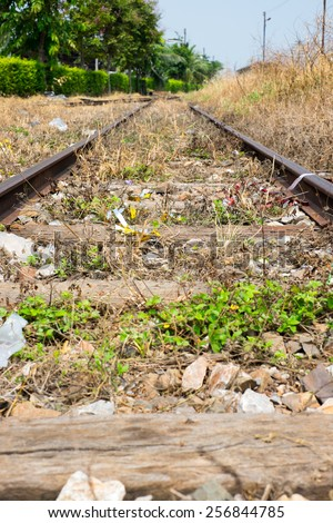Vacant Rail way switch track with yellow die grass. - stock photo