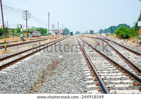 Vacant Rail way with yellow die grass - stock photo