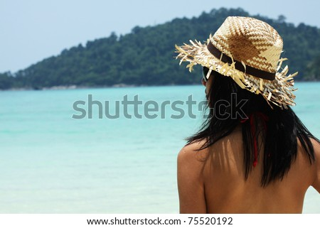 Vacation, A girl standing by the sea ready for her vacation. - stock photo
