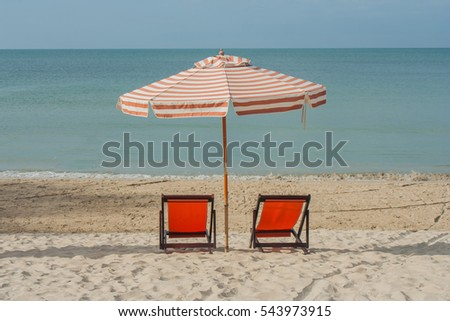 Vacation and Relaxing concept : Chairs with umbrella on beach at Chao Lao Beach, Thailand.