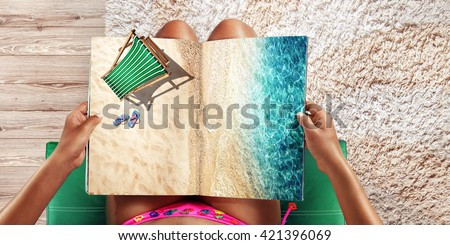Vacation  and Travel. Top view. Young woman on the beach near the sea - stock photo