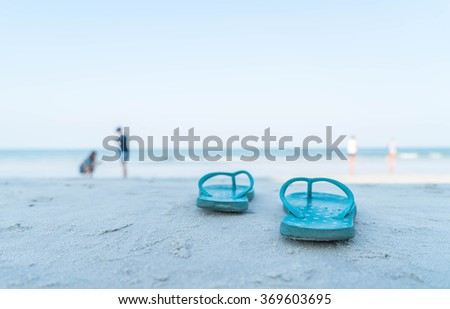 vacation concept--Flipflops on a sandy ocean beach - stock photo