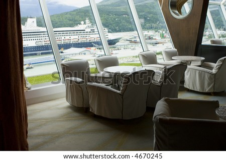 Vacation cruise ship boat lounge with harbor view