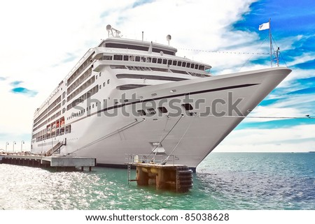 Vacation day cruise ship docked at the pier - stock photo