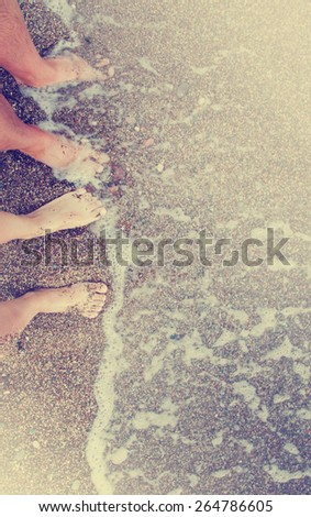 Vacation holidays.Feet closeup of relaxing on beach/ Summer holidays background - stock photo