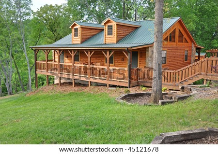 Vacation home made of logs - stock photo
