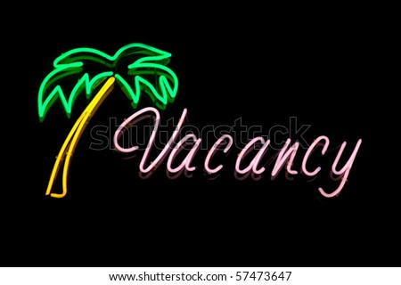 Vacation Image of a Neon Vacancy Sign at a Hotel or Motel Reception - stock photo