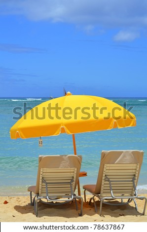 Vacation Image Of Bright Yellow Beach Umbrella And Loungers On Tropical Beach With Copy Space - stock photo