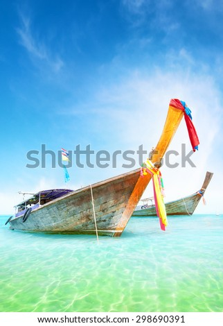 Vacation journey summer background. Traditional thai boats on turquoise water of tropical sea shore - stock photo