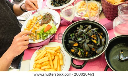 Vacation lunch at the terrace of seaside restaurant  in sunny day. Picardy, France.  - stock photo