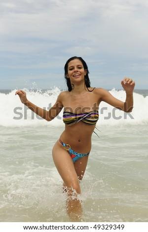 vacation on the beach: sexy girl enjoying the sea - stock photo