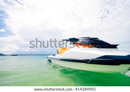 Vacation on the shore. Two water scooter on beach with beautiful sea view. - stock photo