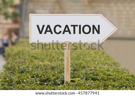 vacation signpost - stock photo