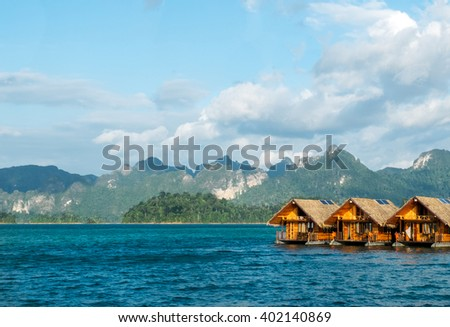 Vacation Start Here Concept, Beautiful Wooden Floating House in Peaceful View of Ratchaprapa dam , Khao sok national park , Surat thani ,Thailand for Traveler to Relax