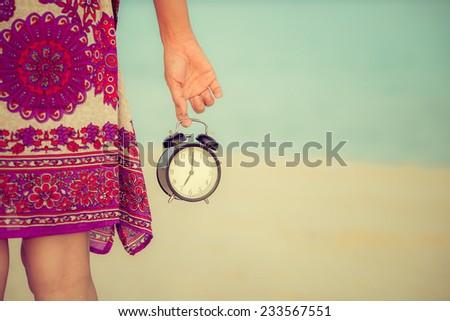 Vacation time concept alarm clock on beach of lipe island, thailand. - stock photo