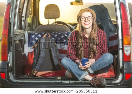 Vacation, travel - woman travel by car. backight