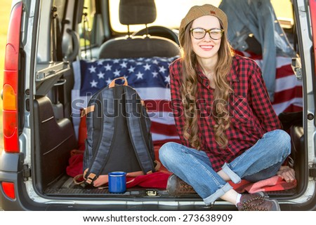 Vacation, travel - woman travel by car. baclkight - stock photo