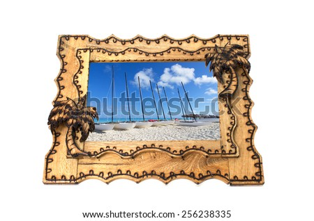 Vacation tropical hand made wooden picture frame on white background - stock photo