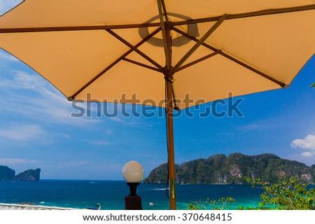 Vacation Wallpaper Under Umbrella  - stock photo