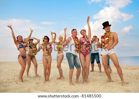 Vacationers have fun at the beach - stock photo