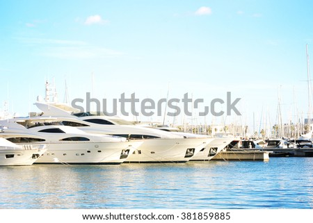 Vacations And Tourism Concept, Beautiful white modern yachts at sea port Alicante, Spain - stock photo