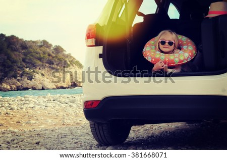 Vacations And Tourism Concept, Little girl in the rent car - stock photo