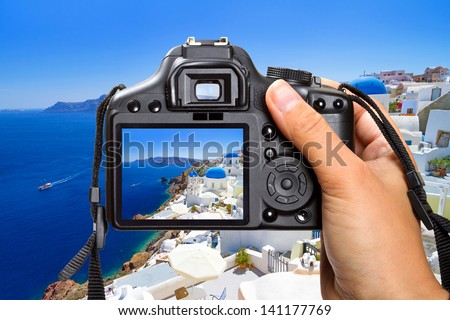 Vacations on Santorini island with the camera, Greece - stock photo