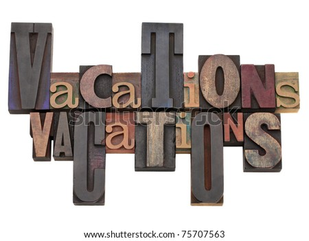 vacations word abstract in antique letterpress printing blocks of different size and style
